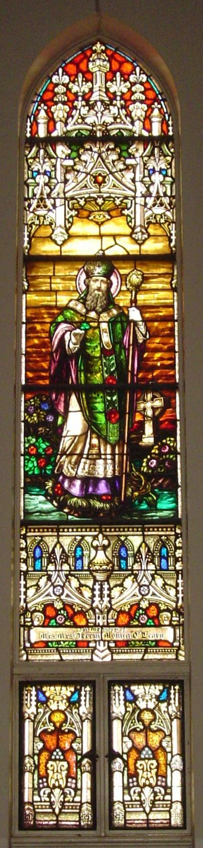 One of many stained glass windows at Holy Name Church